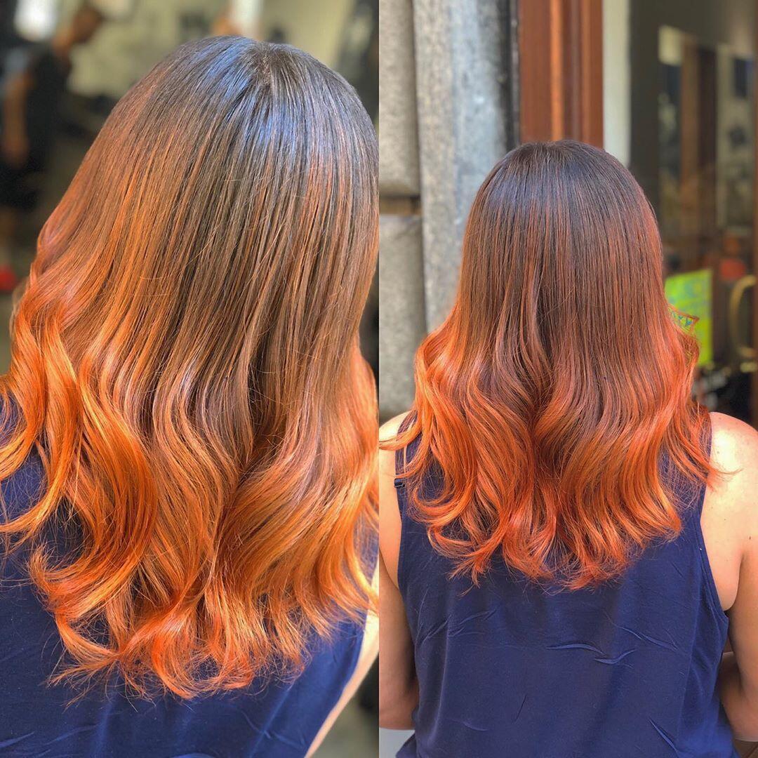 Shatush rosso rame su capelli lunghi e mossi